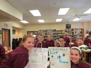 Students at St. Joseph-St. Robert School (Bucks County) are pictured displaying their hand drawn shopping bags during a service project at the school. The bags were then distributed to area retirement residents to enjoy using during their holiday shopping.